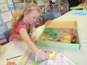 Girl making an electrical circuit