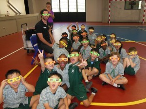 Year 1 students wearing rainbow glasses
