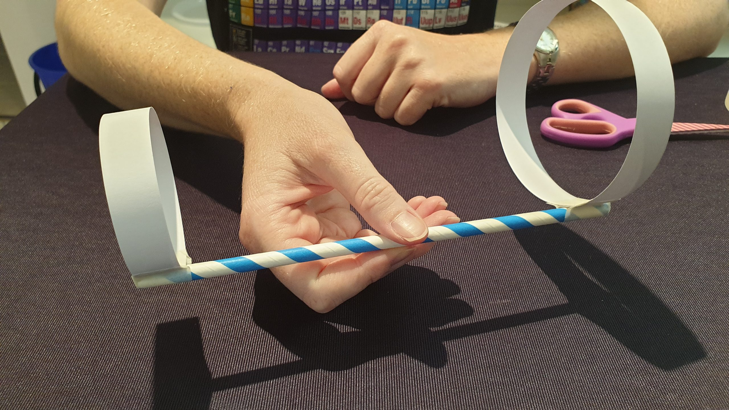 Picture of a hand holding a completed Hoop Glider